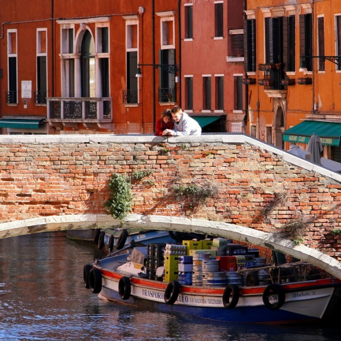 siblings looking at something from the bridge in Venice by Terrill Welch 2014_04_16 088