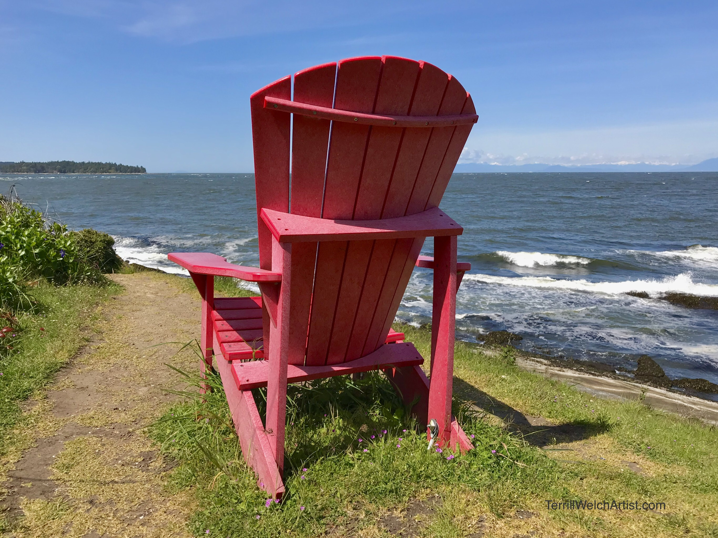 Red Chair over looking ocean.